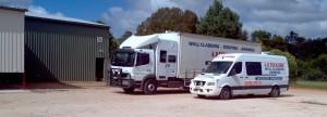 cropped-trucks-warehouse